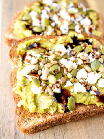 Avocado Toast - Filling avocado toast recipe with chili paste, feta cheese, pumpkin seeds, sunflower seeds and balsamic glaze.