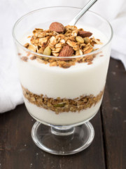 Maple Cinnamon Spiced Granola on yogurt in a cup