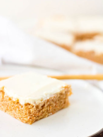 Slice of Carrot Cake Sheet Cake with Cream Cheese Icing on plate