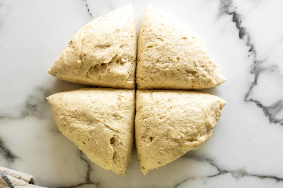 bread bowl dough cut into 4 quarters