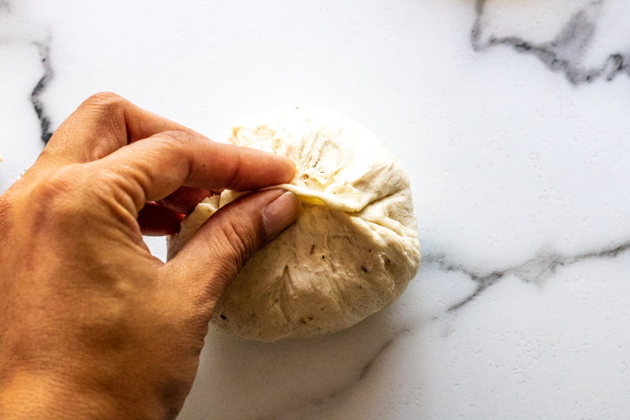pinch closed the bottom of bread bowl dough