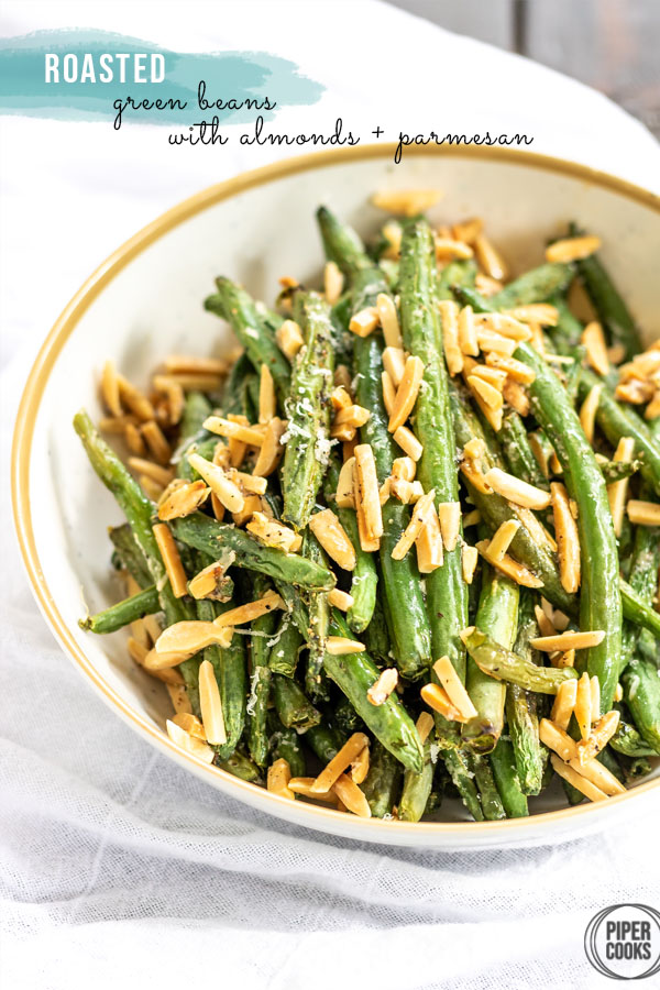 green beans in a bowl with almonds and parmesan cheese