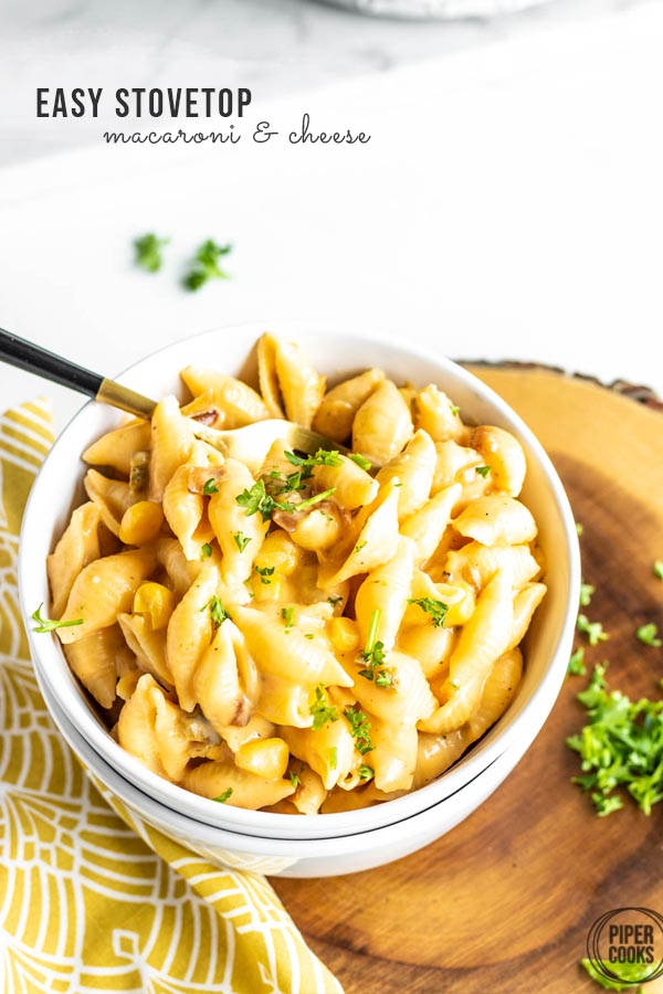 homemade macaroni and cheese in a bowl, pinterest image with text
