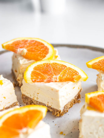 squares of orange creamsicle cheesecake dessert bar