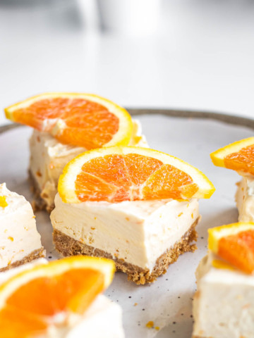 squares of orange creamsicle cheesecake dessert bar