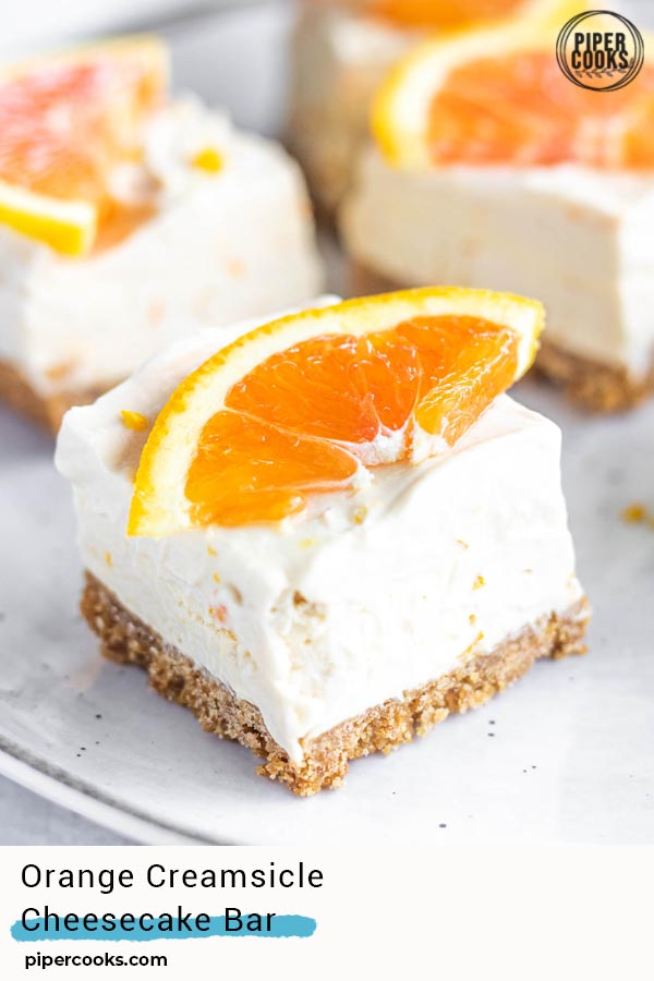 squares of orange creamsicle cheesecake bar with a text overlay for pinterest