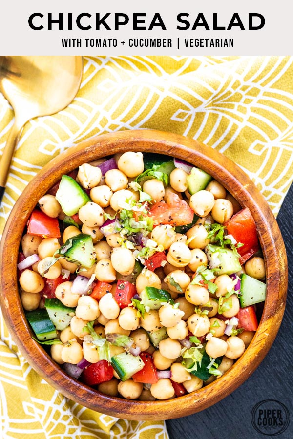 Chickpea Salad with Tomatoes and Cucumber in a bowl with text overlay for Pinterest