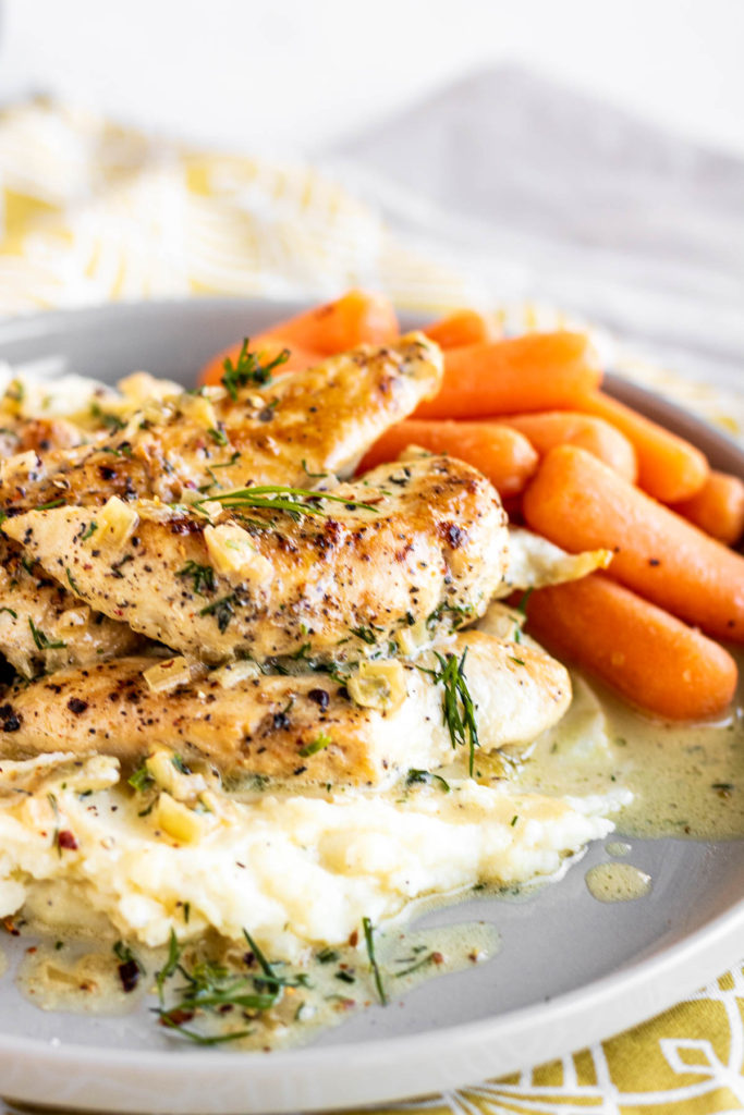 Creamy Dill Chicken on a plate with potatoes & carrots