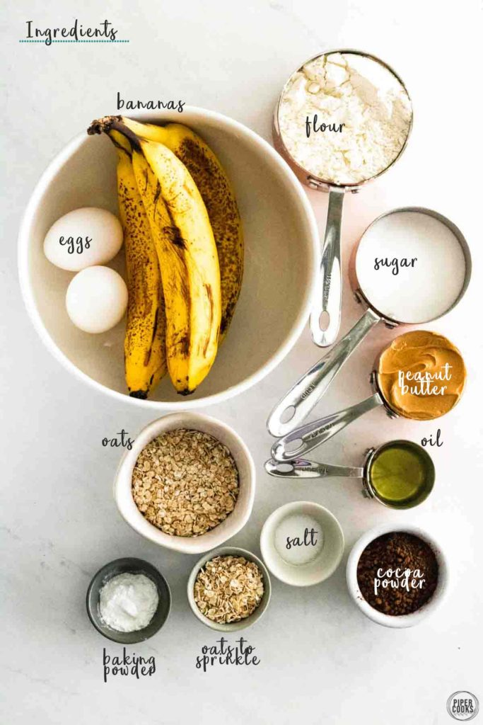 ingredients for banana bread in measuring cups and bowls