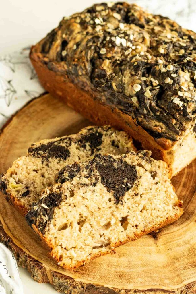 Chocolate Peanut Butter Banana Bread loaf with two slices cut