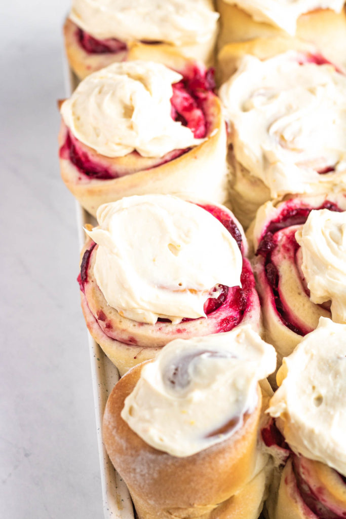 cranberry sweet rolls in a baking pan