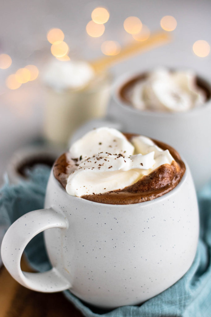 Peppermint Hot Chocolate in a mug with whipped cream on top