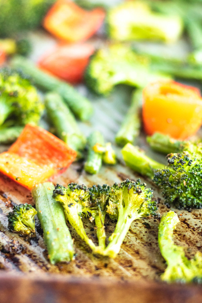 broccoli and red bell pepper on a sheet pan