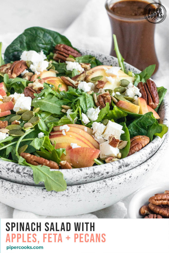 Spinach Salad with Apples in a bowl with text overlay for Pinterest