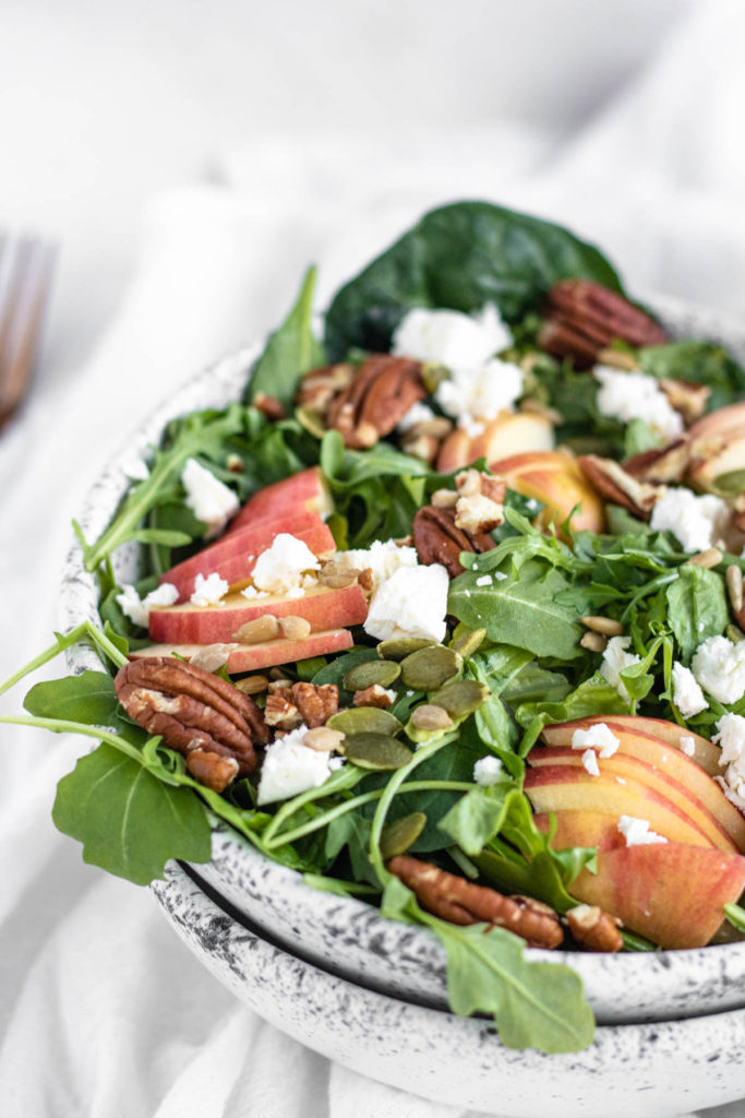 Spinach Salad with Apples in a bowl
