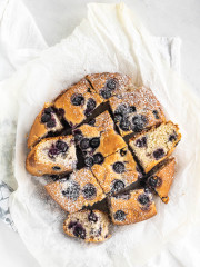 sliced blueberry cake with powdered sugar