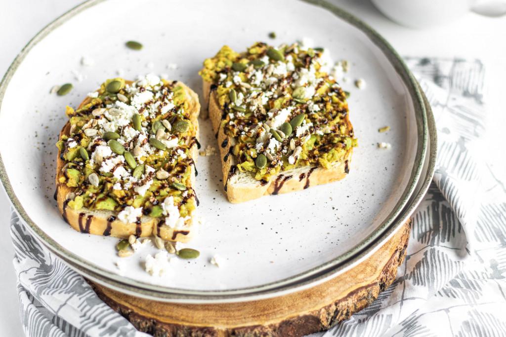 smashed avocado on toast on a plate