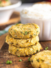 stacked chickpea patties on a wooden platter
