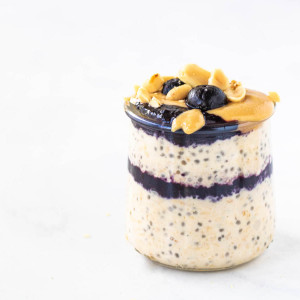 peanut butter and jelly overnight oats in a jar