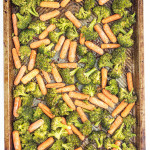 Broccoli and Carrots on a sheet pan with a text overly for Pinterest