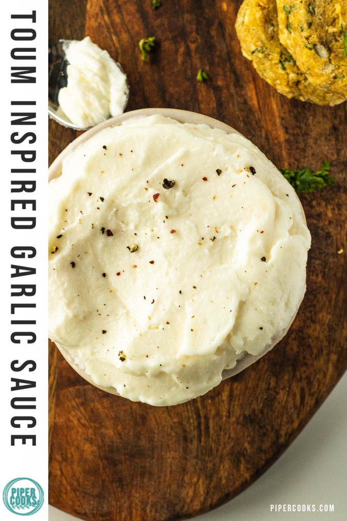 garlic dip in a bowl with text overlay for Pinterest