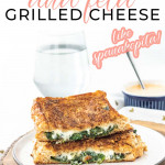 a grilled cheese sandwich cut in half on a plate with a text overlay for pinterest