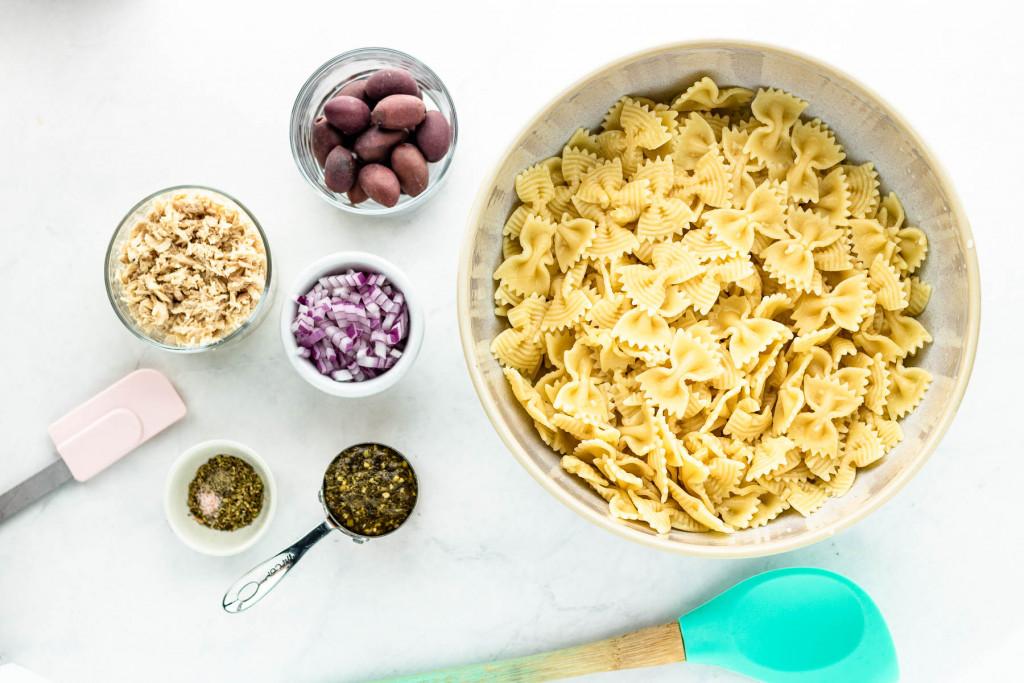 Ingredients in bowls for tuna pesto pasta salad