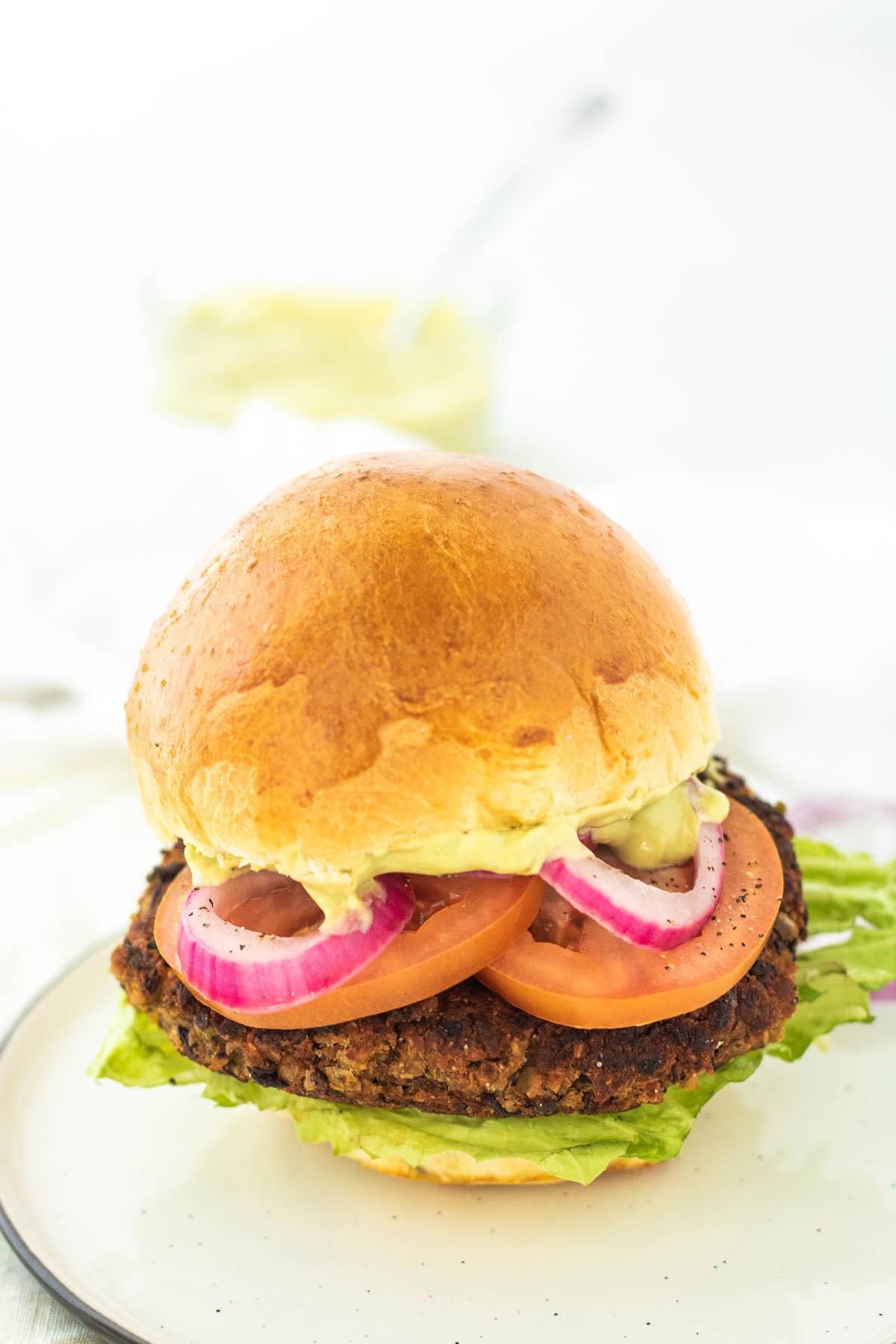 a veggie burger on a plate