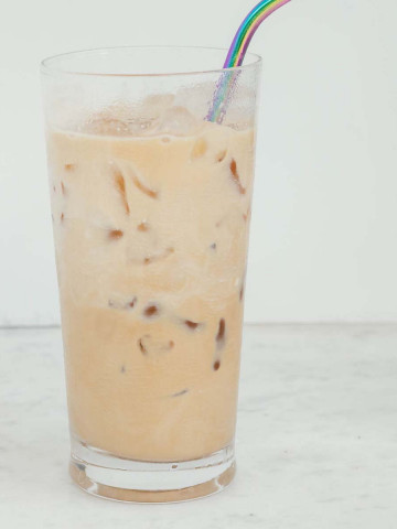 iced coffee in a glass with a straw