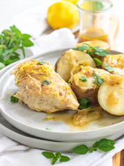 cooked chicken and potatoes on a plate
