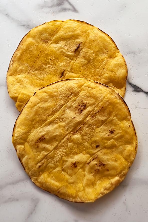 two baked corn tortillas