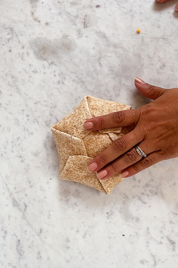 a folded breakfast crunchwrap