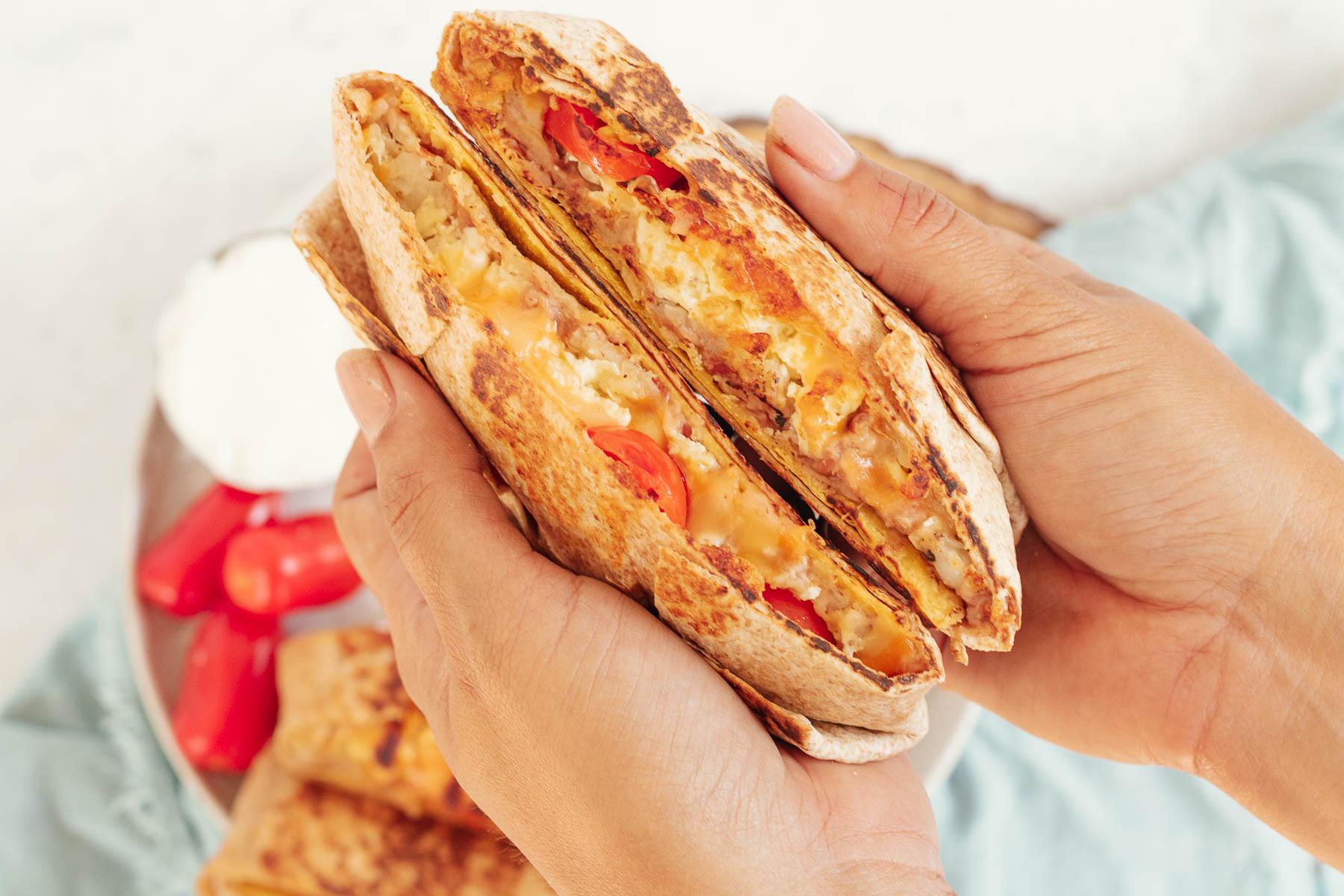 Breakfast Crunchwrap in hands