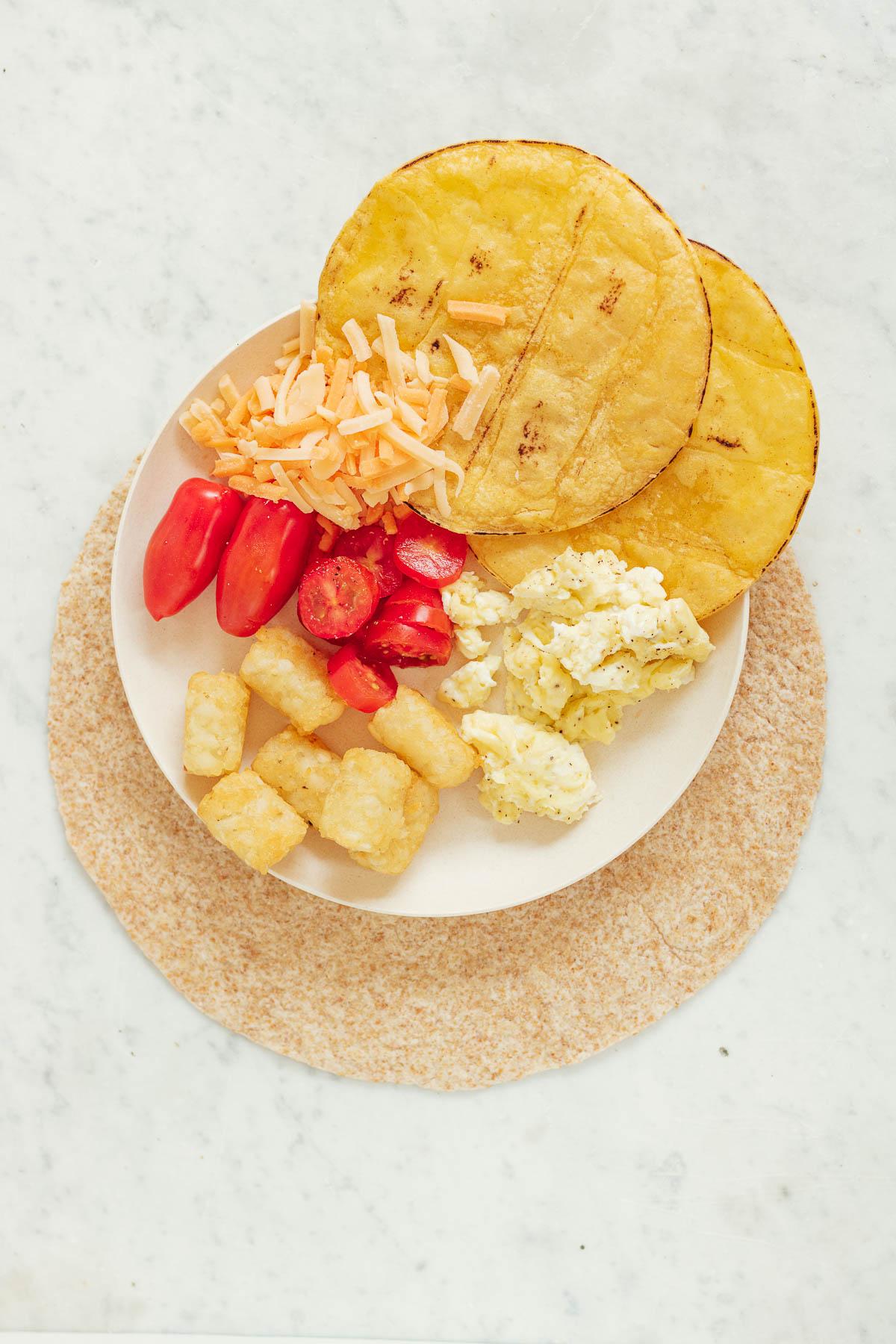 Breakfast Crunchwrap ingredients on a plate