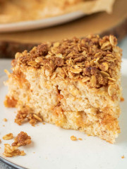 Slice of Cake with streusel topping on a plate