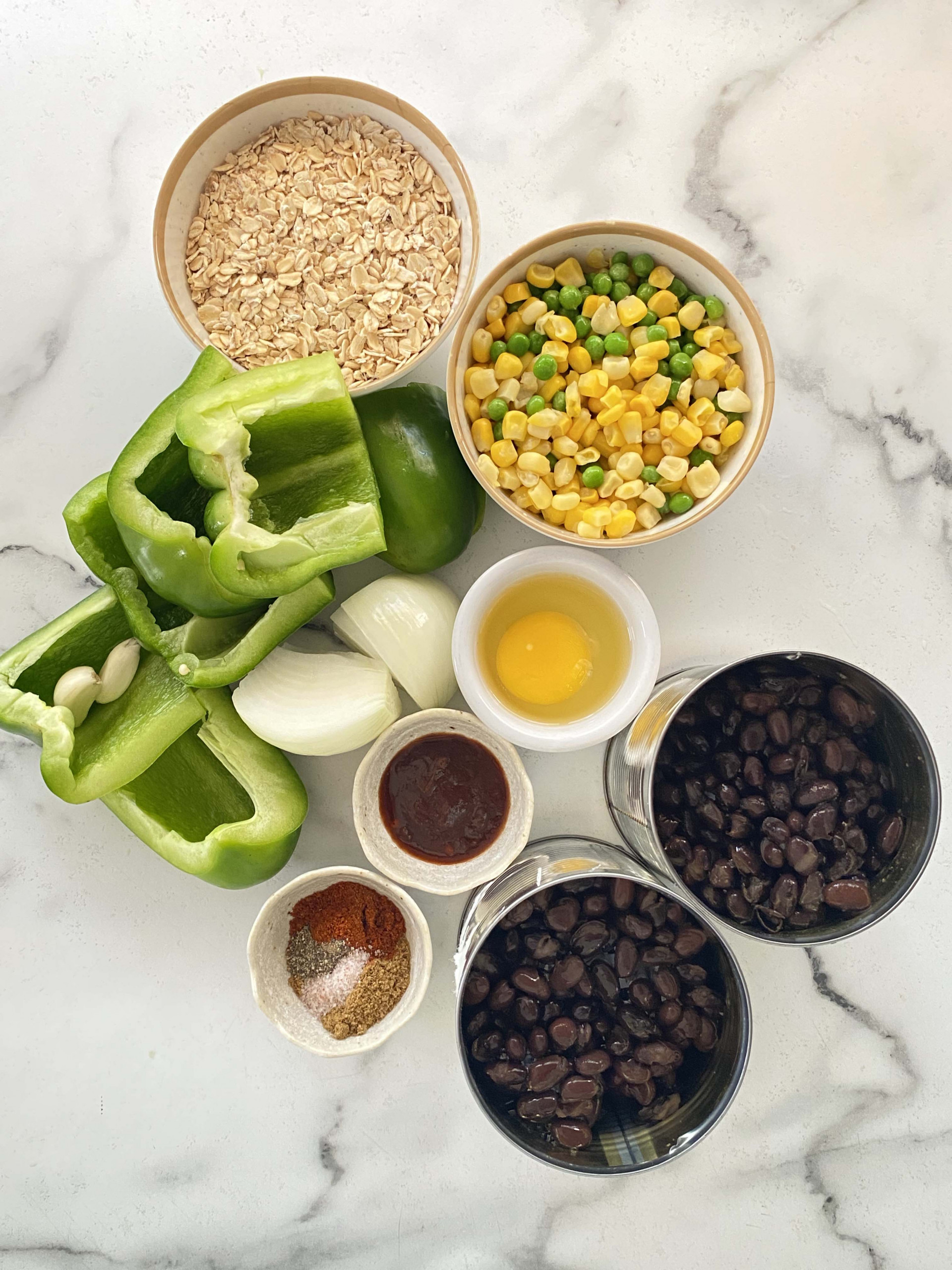ingredients for black bean burgers on a marble top