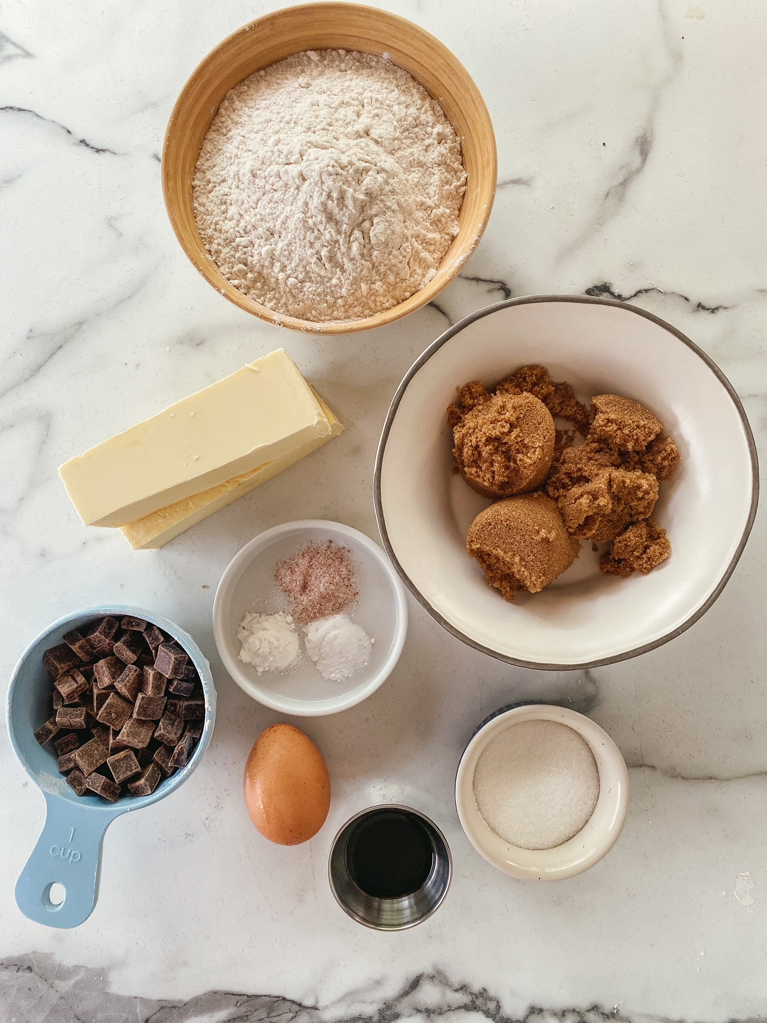 ingredients for chocolate chip cookies on a marble background