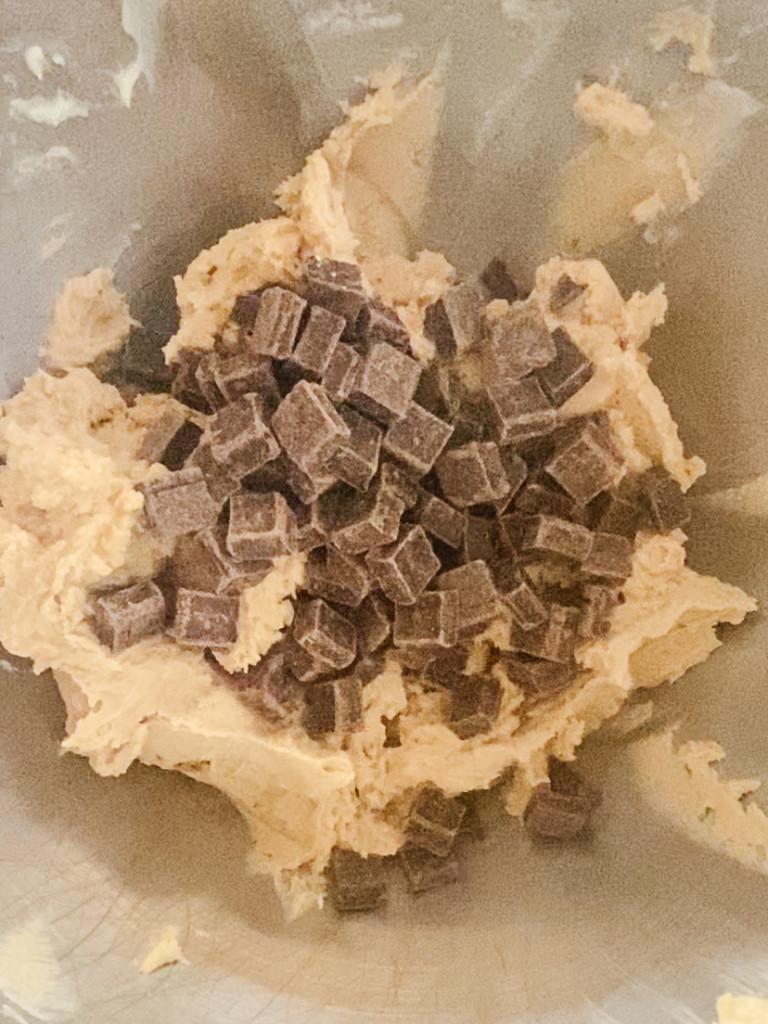 adding chocolate to chocolate chip cookie dough